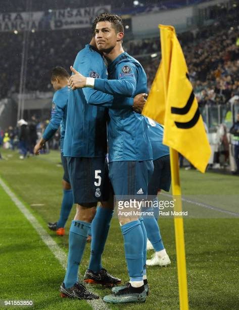 Cristiano Ronaldo of Real Madrid celebrates with Raphael Varane after scoring their team's second goal during the UEFA Champions League Quarter Final...
