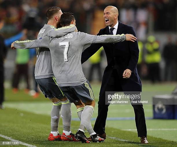 Cristiano Ronaldo of Real Madrid celebrates with Sergio Ramos and head coach Zinedine Zidane after scoring the opening goal during the UEFA Champions...