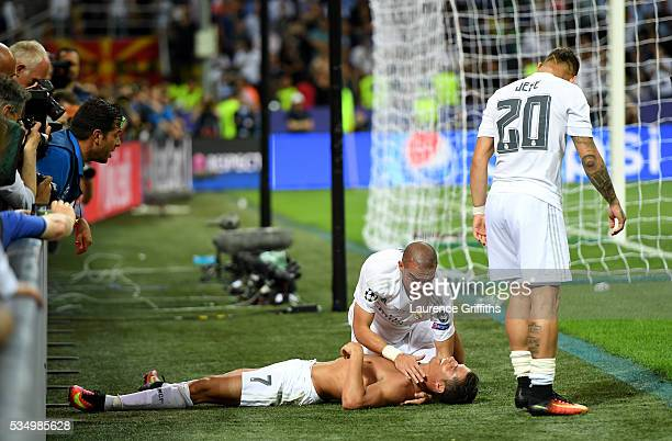 Cristiano Ronaldo of Real Madrid celebrates with team mate Pepe of Real Madrid anf Jese of Real Madrid after scoring the winning penalty during the...