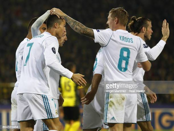 Cristiano Ronaldo of Real Madrid celebrates with team mates after scoring their team's second goal during the UEFA Champions League group H match...