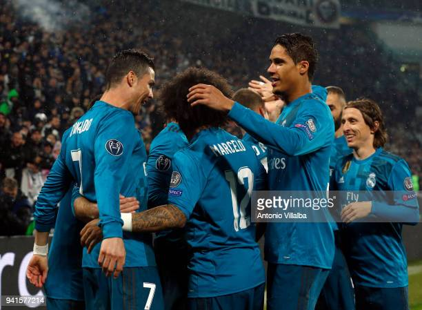 Cristiano Ronaldo of Real Madrid celebrates with team mates after scoring the opening goal during the UEFA Champions League Quarter Final Leg One...