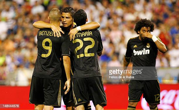Cristiano Ronaldo of Real Madrid celebrates with team mates Karim Benzema and Angel di Maria during the La Liga match between Real Zaragoza and Real...