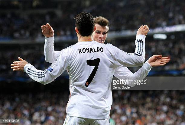 Cristiano Ronaldo of Real Madrid celebrates with teammate Gareth Bale after scoring his team's second goal during the UEFA Champions League Round of...