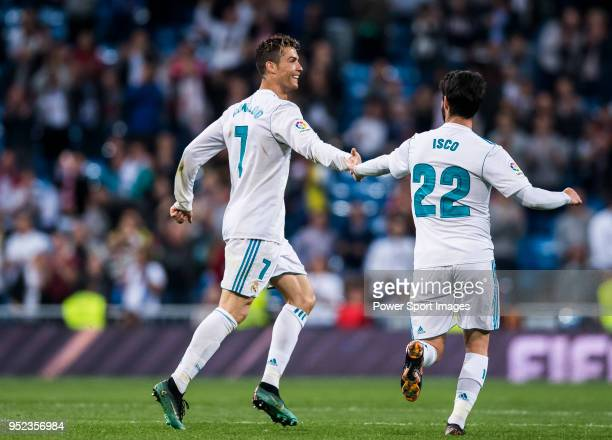 Cristiano Ronaldo of Real Madrid celebrates with teammate Isco Alarcon during the La Liga match between Real Madrid and Athletic Club at Estadio...