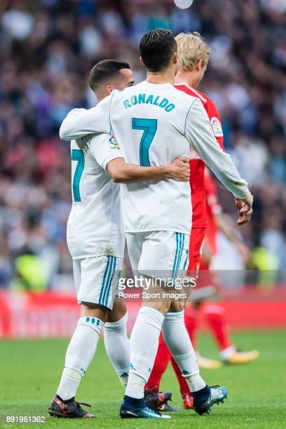 Cristiano Ronaldo of Real Madrid celebrates with teammate Lucas Vazquez after scoring a penalty during the La Liga 201718 match between Real Madrid...