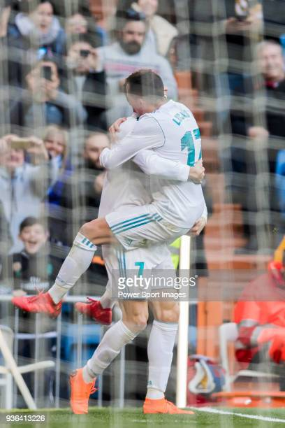 Cristiano Ronaldo of Real Madrid celebrates with teammate Lucas Vazquez during the La Liga 201718 match between Real Madrid and Deportivo Alaves at...
