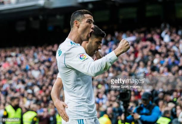 Cristiano Ronaldo of Real Madrid celebrates with teammate Marco Asensio Willemsen during the La Liga 201718 match between Real Madrid and Sevilla FC...