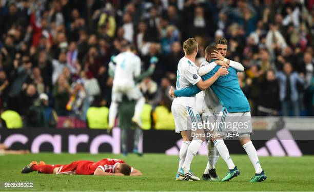 Cristiano Ronaldo of Real Madrid celebrates with teammates after his team drew 22 against Bayern Muenchen to qualify for the final during the UEFA...