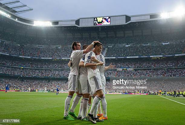 Cristiano Ronaldo of Real Madrid celebrates with teammates after scoring the opening goal from the penalty spot during the UEFA Champions League Semi...