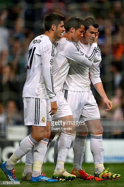 Cristiano Ronaldo of Real Madrid celebrates with teammates Gareth Bale and Alvaro Morata after scoring the opening goal during the UEFA Champions...