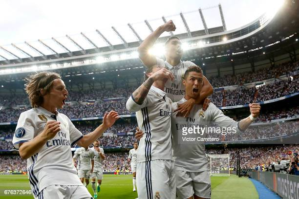 Cristiano Ronaldo of Real Madrid celebrates with teammates Luka Modric Sergio Ramos and Casemiro after scoring the opening goal during the UEFA...