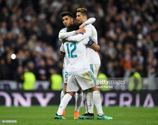 Cristiano Ronaldo of Real Madrid celebrates with teammates Marco Asensio and Marcelo after scoring his sides first goal during the UEFA Champions...