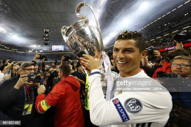 Cristiano Ronaldo of Real Madrid celebrates with The Champions League trophy after the UEFA Champions League Final between Juventus and Real Madrid...