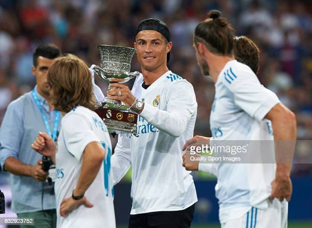 Cristiano Ronaldo of Real Madrid celebrates with the trophy after wining the Supercopa de Espana Supercopa Final 2nd Leg match between Real Madrid...
