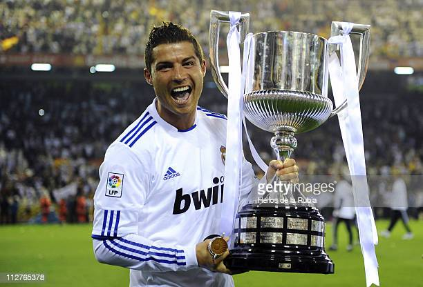 Cristiano Ronaldo of Real Madrid celebrates with the trophy after the Copa del Rey Final between Barcelona and Real Madrid at Estadio Mestalla on...