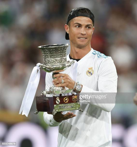 Cristiano Ronaldo of Real Madrid celebrates with the trophy after the Supercopa de Espana Final second leg match between Real Madrid and FC Barcelona...