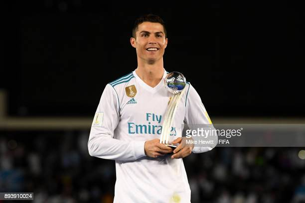 Cristiano Ronaldo of Real Madrid celebrates with the trophy after the FIFA Club World Cup UAE 2017 Final between Gremio and Real Madrid at the Zayed...