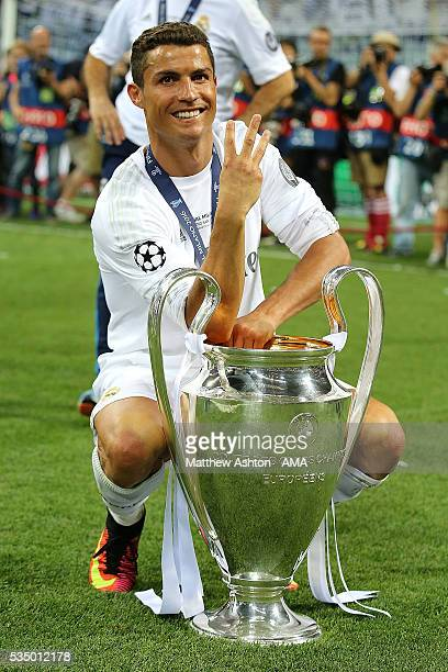 Cristiano Ronaldo of Real Madrid celebrates with the trophy following his team's victory in a penalty shootout during the UEFA Champions League final...