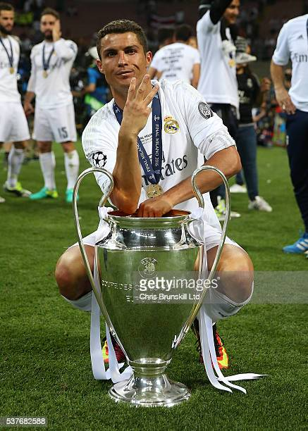 Cristiano Ronaldo of Real Madrid celebrates with the trophy following the UEFA Champions League Final between Real Madrid and Club Atletico de Madrid...