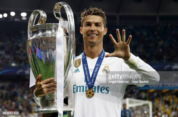 Cristiano Ronaldo of Real Madrid celebrates with The UEFA Champions League trophy following his sides victory in the UEFA Champions League Final...