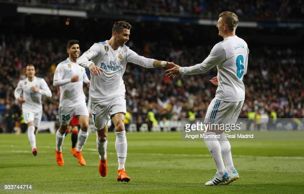 Cristiano Ronaldo of Real Madrid celebrates with Toni Kroos after scoring the opening goal during the La Liga match between Real Madrid and Girona at...