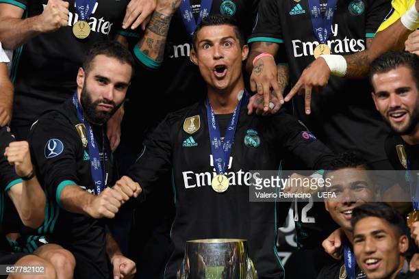 Cristiano Ronaldo of Real Madrid celebrates with UEFA Super Cup trophy after the UEFA Super Cup final between Real Madrid and Manchester United at...