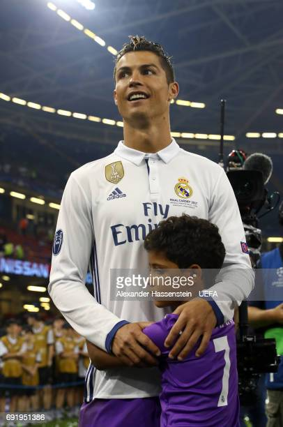 Cristiano Ronaldo of Real Madrid celerbates with his son after the UEFA Champions League Final between Juventus and Real Madrid at National Stadium...