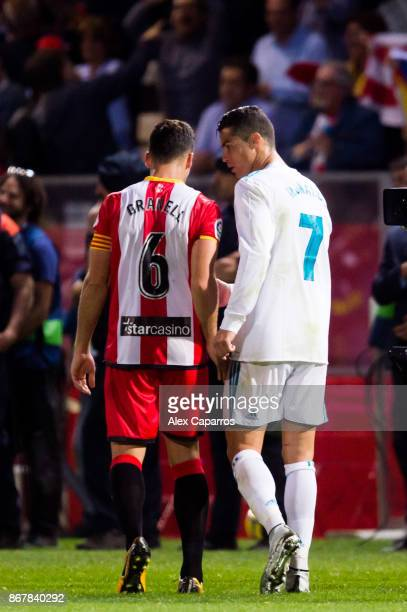 Cristiano Ronaldo of Real Madrid CF and Alex Granell of Girona FC speak at the end of the La Liga match between Girona and Real Madrid at Estadi de...