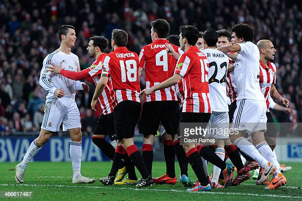 Cristiano Ronaldo of Real Madrid CF argues with Athletic Club players during the La Liga match between Athletic Club and Real Madrid CF at San Mames...
