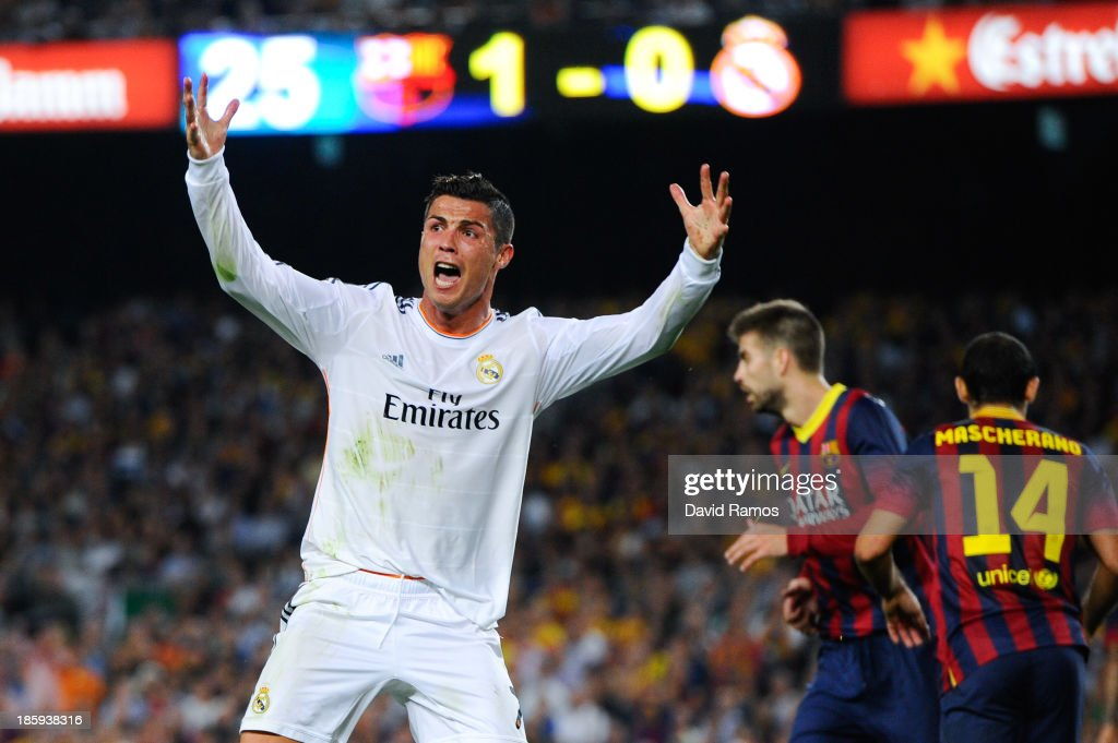 Cristiano Ronaldo of Real Madrid CF argues with the referee after being brought down during the La Liga match between FC Barcelona and Real Madrid CF at Camp Nou on October 26, 2013 in Barcelona, Spain.