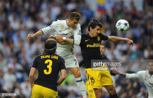 Cristiano Ronaldo of Real Madrid CF beats Stefan Savic of Club Atletico de Madrid to score his team's opening goal in the UEFA Champions League Semi...