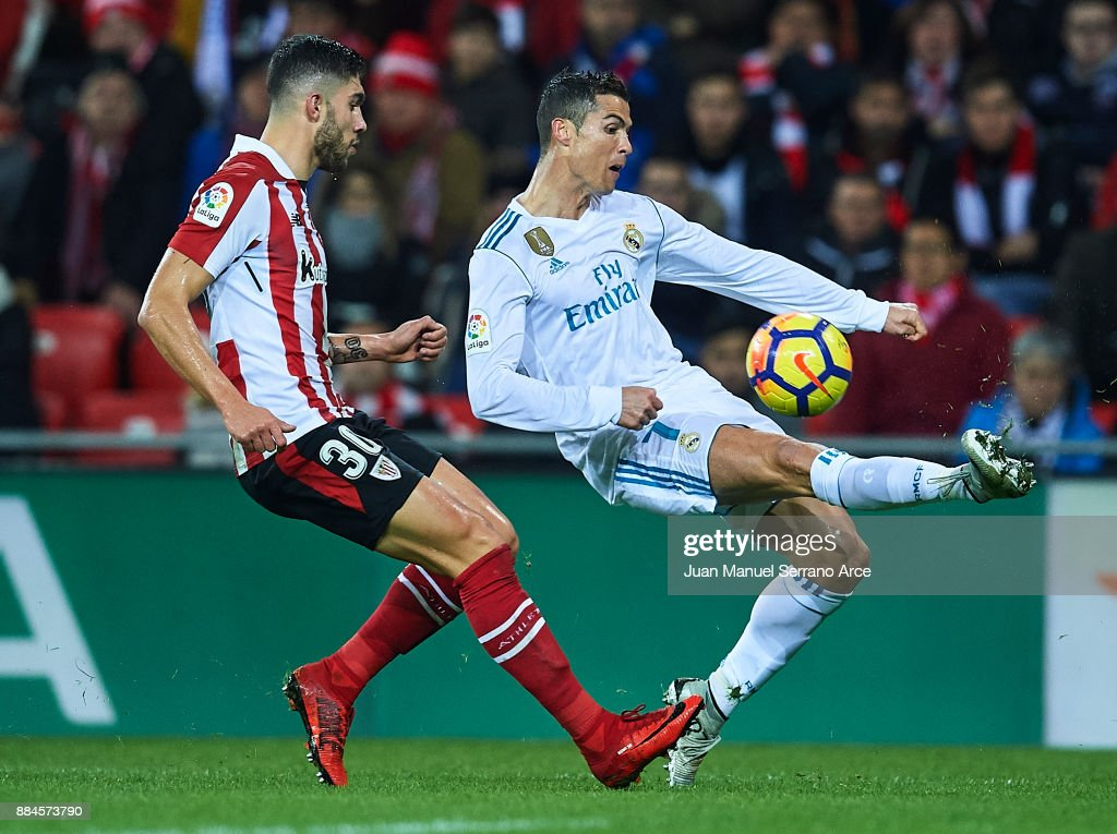 Cristiano Ronaldo of Real Madrid CF (R) being followed by Inigo Cordoba of Athletic Club (L) during the La Liga match between Athletic Club and Real Madrid at Estadio de San Mames on December 2, 2017 in Bilbao, Spain.
