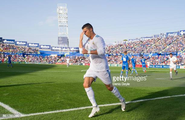 Cristiano Ronaldo of Real Madrid CF celebrates after scoring his team's 2nd goal during the La Liga match between Getafe and Real Madrid at Coliseum...