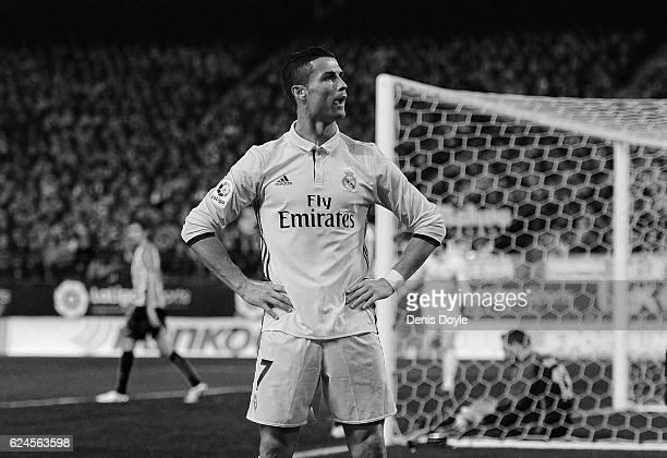 Cristiano Ronaldo of Real Madrid CF celebrates after scoring his 3rd goal against Club Atletico de Madrid at Vicente Calderon stadium on November 19...