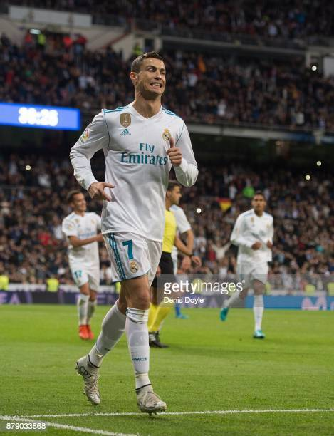 Cristiano Ronaldo of Real Madrid CF celebrates after scoring his team's 3rd goal from a penalty rebound during the La Liga match between Real Madrid...