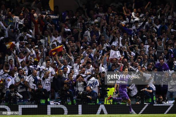 Cristiano Ronaldo of Real Madrid CF celebrates after scoring his team's second goal during the UEFA Champions League Final between Juventus and Real...
