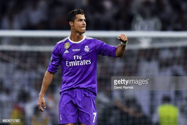 Cristiano Ronaldo of Real Madrid CF celebrates after scoring his team's third goal during the UEFA Champions League Final between Juventus and Real...