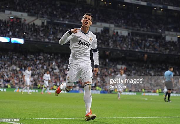 Cristiano Ronaldo of Real Madrid CF celebrates after scoring Real's 2nd goal during the La Liga match between Real Madrid CF and Malaga CF at estadio...
