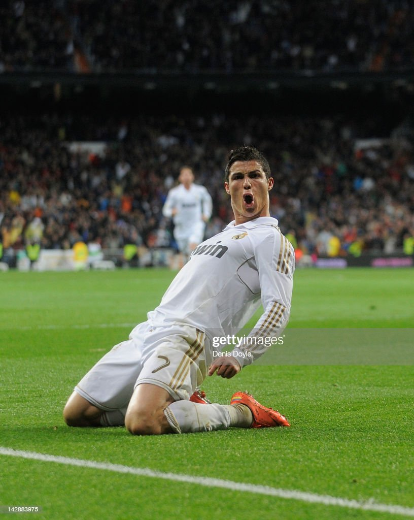 Cristiano Ronaldo of Real Madrid CF celebrates after scoring their second goal during the La Liga match between Real Madrid CF and Real Sporting de Gijon at Estadio Santiago Bernabeu on April 14, 2012 in Madrid, Spain.