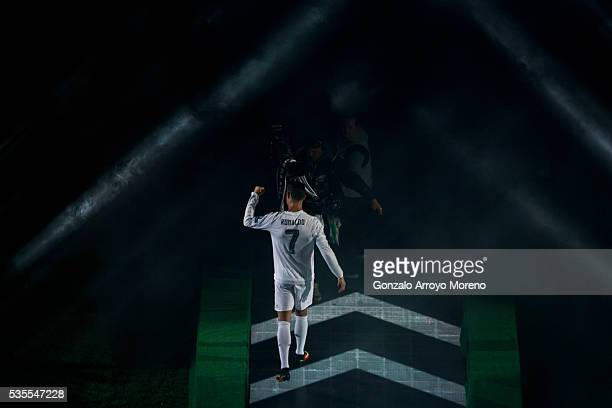 Cristiano Ronaldo of Real Madrid CF celebrates as he enters the pitch during Real Madrid CF team celebration at Santiago Bernabeu Stadium the day...