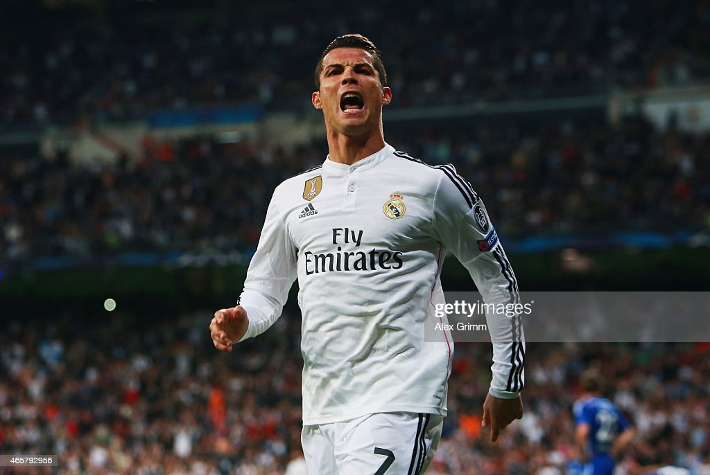 Cristiano Ronaldo of Real Madrid CF celebrates as he scores their second goal during the UEFA Champions League Round of 16 second leg match between Real Madrid CF and FC Schalke 04 at Estadio Bernabeu on March 10, 2015 in Madrid, Spain.