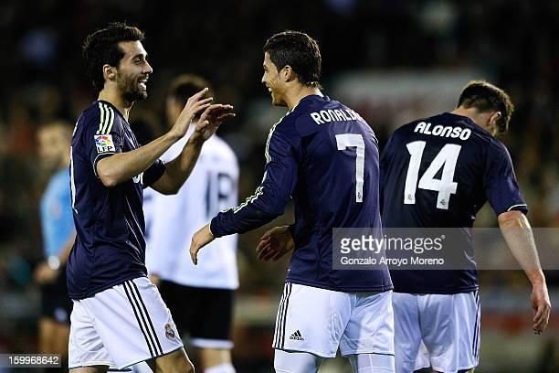 Cristiano Ronaldo of Real Madrid CF celebrates scoring his first goal with teammate Alvaro Arbeloa during the La Liga match between Valencia CF and...