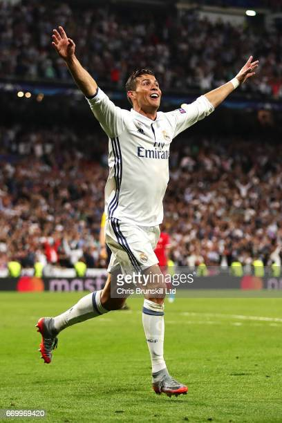 Cristiano Ronaldo of Real Madrid CF celebrates scoring his side's third goal during the UEFA Champions League Quarter Final second leg match between...