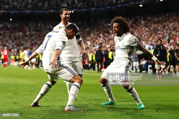 Cristiano Ronaldo of Real Madrid CF celebrates scoring his side's third goal with teammate Marcelo during the UEFA Champions League Quarter Final...