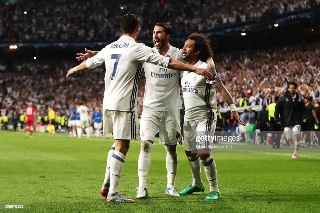 Cristiano Ronaldo of Real Madrid CF celebrates scoring his team's third goal with team-mates Sergio Ramos and Marcelo (R) during the UEFA Champions League Quarter Final second leg match between Real Madrid CF and FC Bayern Muenchen at Estadio Santiago Bernabeu on April 18, 2017 in Madrid, Spain.