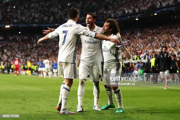 Cristiano Ronaldo of Real Madrid CF celebrates scoring his team's third goal with teammates Sergio Ramos and Marcelo during the UEFA Champions League...