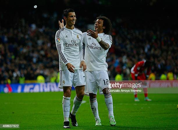 Cristiano Ronaldo of Real Madrid CF celebrates scoring their fifth goal with teammate Marcelo during the La Liga match between Real Madrid CF and...
