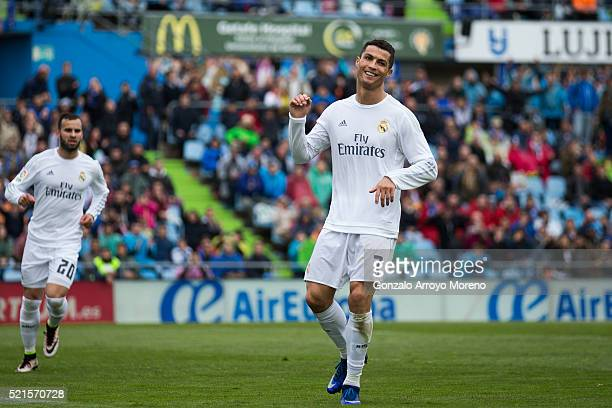 Cristiano Ronaldo of Real Madrid CF celebrates scoring their fifth goal during the La Liga match between Getafe CF and Real Madrid CF at Coliseum...