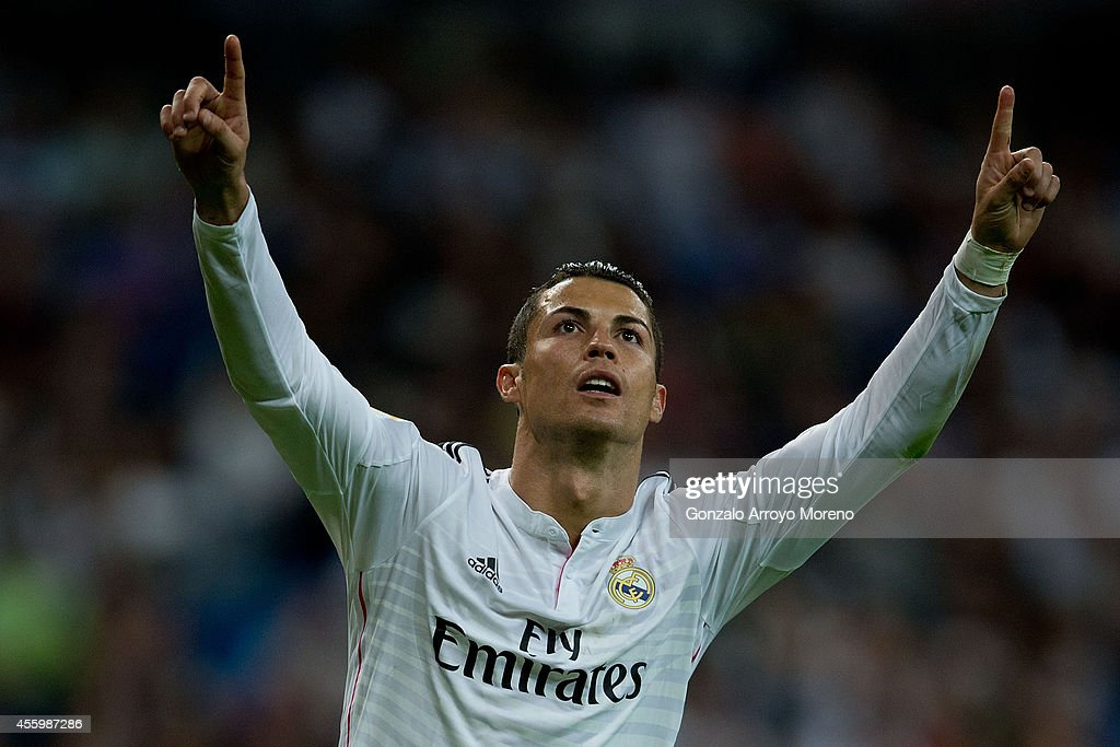 Cristiano Ronaldo of Real Madrid CF celebrates scoring their fourth goal from a penalty shot during the La Liga match between Real Madrid CF and Elche CF at Estadio Santiago Bernabeu on September 23, 2014 in Madrid, Spain.