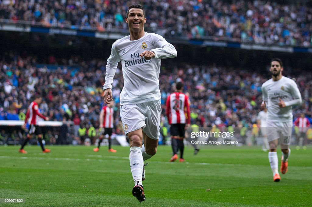 Cristiano Ronaldo (R) of Real Madrid CF celebrates scoring their fourth goal during the La Liga match between Real Madrid CF and Athletic Club at Estadio Santiago Bernabeu on February 13, 2016 in Madrid, Spain.